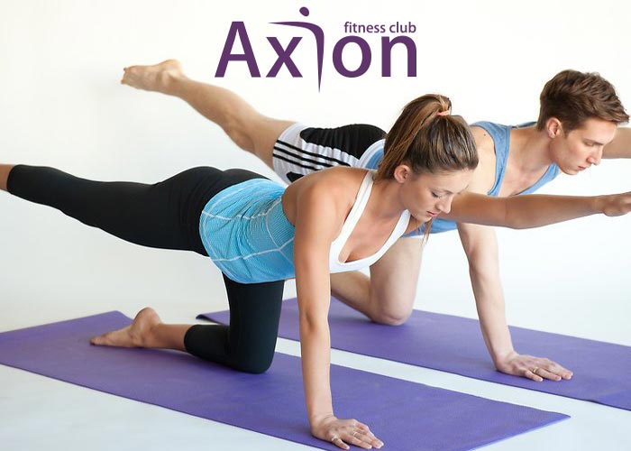 A man and a woman performing pilates in halandri, at axiongym.